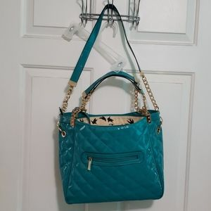 Shiny teal purse